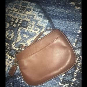 Brown leather coach wristlet
